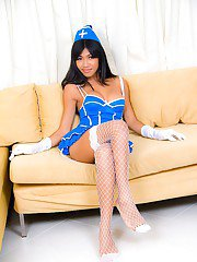 Gorgeous ladyboy nurse Narnia masturbating in fishnet stockings