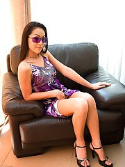 Hot Asian ladyboy Oom looking sexy in glasses skirt and high heels