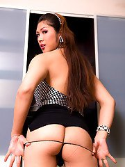 Pretty ladyboy Sakura shows off her tight ass and jerks off cock