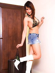 Beautiful Asian shemale Tam poses in short shorts and tall boots