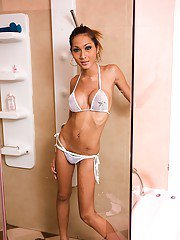 Skinny Asian tranny Yoyo takes a shower after bikini removal