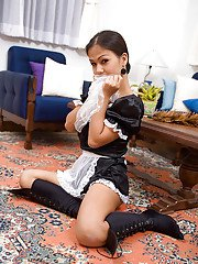 Slutty Asian shemale Amy posing in a hot maid costume spreading her legs