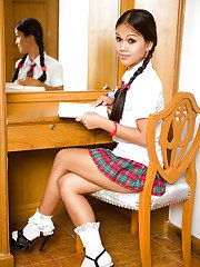 Young Asian tranny Amy taking off her sexy schoolgirl uniform