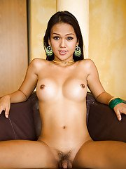 Big tit Thai ladyboy Amy showing off her nasty asshole and small cock