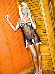 Horny blonde Asian shemale Kai showing off her big tits in lingerie