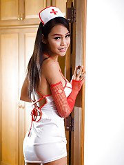 Hot ladyboy nurse Wawa poses in fishnet stockings and nurses uniform