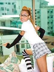 Cute Asian shemale Noon poses in socks schoolgirl skirt and glasses