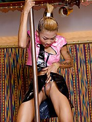Nice upskirts of busty Asian tranny Moo working out on stripper pole