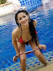 Outdoor poolside shots of Asian ladyboy Chompoo stripping naked