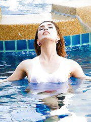 Hot Asian ladyboy Nueng appears pool side in wet tshirt and topless