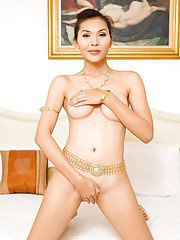 Pretty Asian shemale Jenny toys her hairy tranny pussy with big dildo