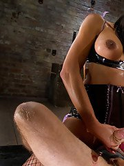 Gorgeous Asian shemale dominatrix Yasmin Lee stretching her slaves ass
