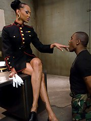 Lustful Ebony tranny Foxy humiliating and spanking a man in uniform