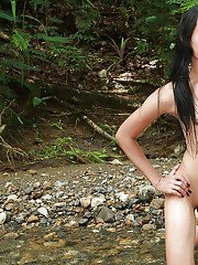 Cute Ladyboy Shane removes her bikini to flash her privates outdoors