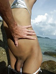 Young and hot Thai dickgirl proudly showing her hard meat on a Phuket