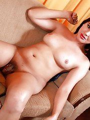 Jin strips in front of her webcam to flash her nice boobies and her small dick