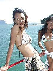 Stunning Asian shemales getting kinky with each other on a boat