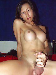 Busty brunette Asian ladyboy jerking off and cumming on her stomach