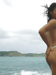 Hot petite ladyboy stripping and flashing her yummy body on a tropical beach