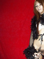 Extremely beautiful Asian ladyboy playing with her cock in lingerie