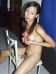 Skinny Asian tranny masturbating passionatuely in a hot black outfit