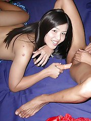 Two Asian shemales toying assholes and jerking cocks for cumshots