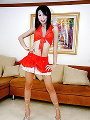 Beautiful Asian tranny Bel posing in high heels and sexy skirt