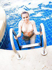 Young Thai shemale Poppy strip off her bikini to naked beside pool