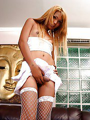 Hot blonde Thai ladyboy Noon showing off her boner in white stockings