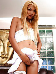 Long-haired Asian shemale Noon is getting pleasure from wanking