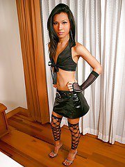 Cute June poses in her hot black latex skirt and cute small bra