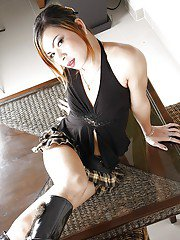 Hot luscious Thai tranny Bell Tai spreading her legs in black boots