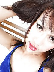 Brunette teen Asian tranny X posing in a blue dress in her bedroom