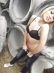Blonde Asian tranny showing off her cock and small tits outdoors