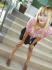Blonde small tit Asian tranny Wa showing off her hung cock outdoors