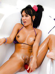Cute Thai shemale Nid having fun with her toys and stuffing her wet pussy