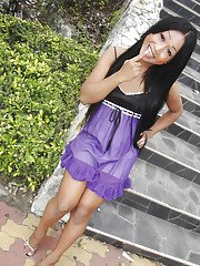 Cute small tit Thai ladyboy Kem posing in high heels and stroking her cock