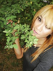 Skinny Asian ladyboy Mic shows off small boobs and hairy dick outdoors