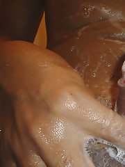 Pierced Thai shemale Baba soaps up her big tranny penis in shower