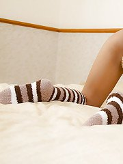 Beautiful Thai shemale One posing seductively in socks and mitts