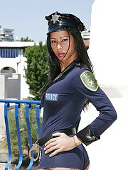 Slutty brunette tranny in a cop uniform enjoying a kinky threesome