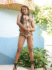 Muscular young Ebony shemale Rafaella gagging on a hard cock by a pool
