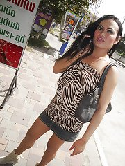 Horny Asian tranny Aom posing in public before showing off her hairy cock