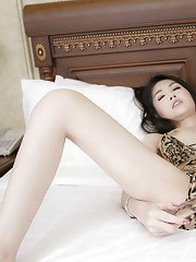 Skinny pale Asian shemale Tukta fingering and toying her tight pussy