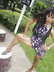 Skinny Asian tranny Tuntu posing outdoors and playing with her hairy cock