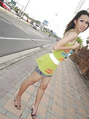 Tiny Asian tranny teen Poppy showing off her long legs outdoors