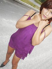 Cute redhead Asian ladyboy Tonkra playing with herself outdoors