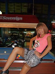 Skinny Asian tranny Jess posing outdoors in a skirt and high heels
