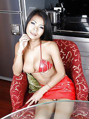 Busty ladyboy Paeng jerking off her hung tranny cock in kitchen