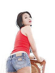 Gorgeous Asian shemale Rose strips off denim shorts and exposes pussy